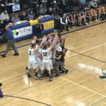 The Negaunee Miners hoist up the District Championship trophy!