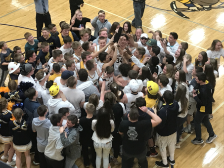 The Negaunee Miners celebrate with the student section after their 49-47 Distict title win over the Gwinn Modeltowners on 101.9 SunnyFM.