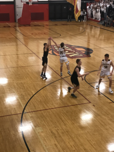 The Miners attempt a three-pointer in their 51-40 loss to the Iron Mountain Mountaineers on 101.9 SunnyFM.