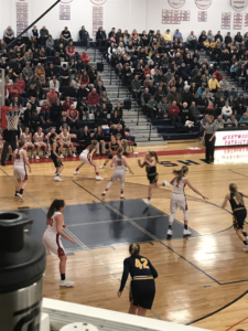 The Miners control the ball on the wing, looking to score against the Westwood defense on 101.9 SunnyFM. The Patriots defeated Miners 49-37 to advance to Wednesday's District 66 semi-final game.