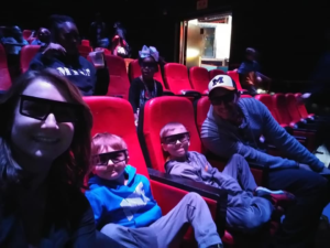 Kelsey, Titan, Holden, and Cody at LegoLand 4D Theater watching Lego Ninjago