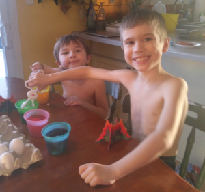 Titan and Holden coloring Easter eggs, April 2019