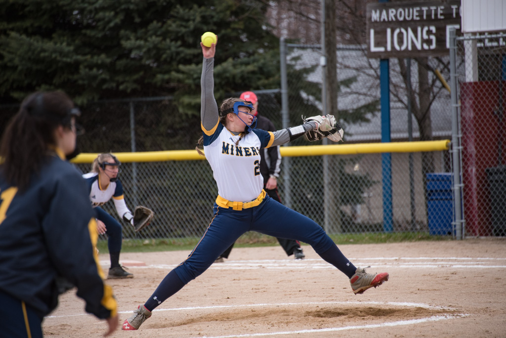 Negaunee Miners Varsity Pitcher Skylar Hall throwing against the Marquette Redettes.