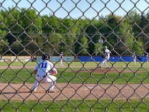 The Gladstone Braves complete a pitching change later in the game