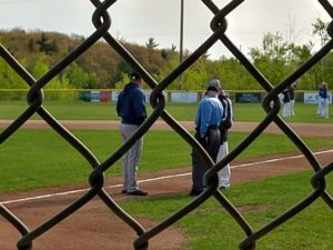 Some pregame strategizing through the fence as Negaunee prepared to take on Superior Central in the HS baseball District Semifinal game.
