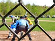 Negaunee winds up for a swing at a Superior Central pitch.