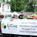 Throwing candy from the Active Physical therapy truck in the Pioneer Days parade