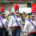 Band members wave to the audience during the Pioneer Days Festival parade