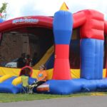 Kids enjoy the bouncy house at this years Pioneer Days Festival