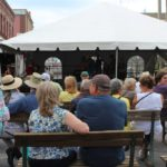 People enjoy the music of the local bands at the Blueberry Festival