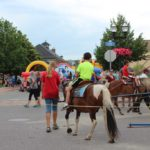 Making the rounds with the ponies during the blueberry festival