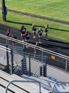 Negaunee's cheerleaders prepare for kickoff between the Miners and Mountaineers.