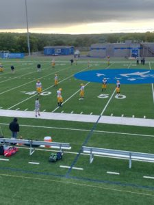 The Negaunee Miners warming up before their huge 28-19 win over the Hancock Bulldogs on Sunny 101.9.