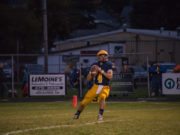 Quarterback Jason Waterman drops back to pass for Negaunee.