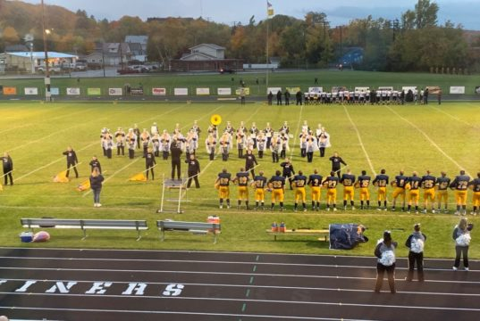 The Negaunee High School Marching Miner Band performs the national anthem prior to Negaunee defeating Gogebic 42-16 in a battle of the Miners on Sunny 101.9.