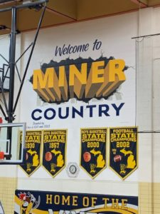 "Negaunee defended its home turf of ""Miner Country"" with a big 16-point win over Houghton on Sunny 101.9."
