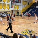 Negaunee and Houghton battled in the post all night long, but it was the Miners who came out on top.