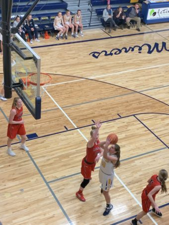 Alyssa Hill looks to score in the paint for the Miners in their 35-32 loss to the Marquette Redettes on Sunny 101.9.