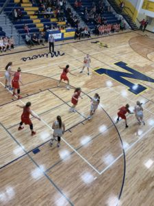 The Miners possess the ball against the Redettes' defense on Sunny 101.9.