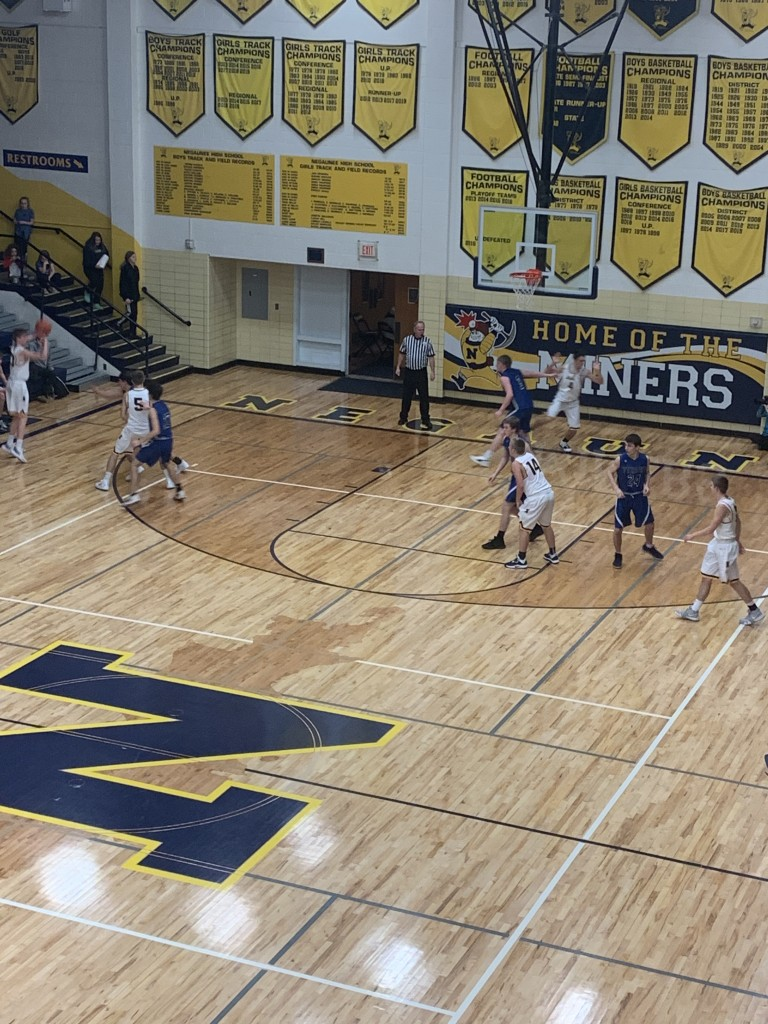 Jakson Sager controls the ball for the Miners in his team's 68-48 win over the West Iron County Wykons on Sunny 101.9.