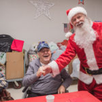 Santa taking a pre-birthday photos with one of the veterans. His birthday is tomorrow!