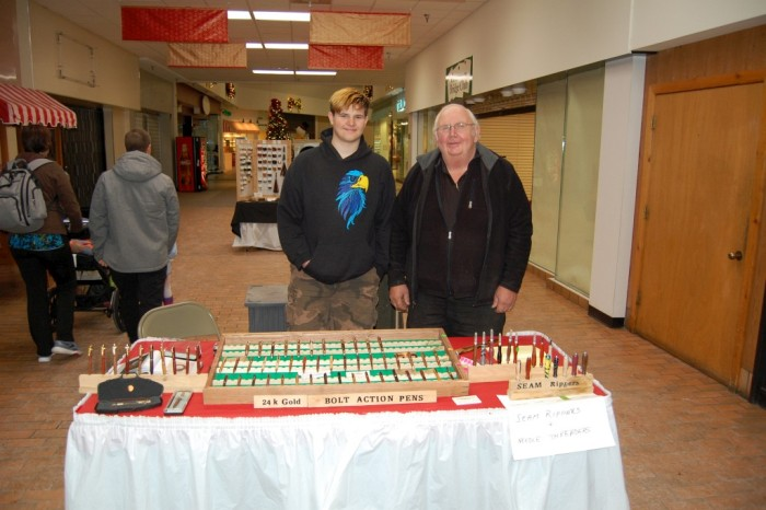 Music at the Mall - Don Johnson pens and seam rippers, with grandnson Ethan Lindquist