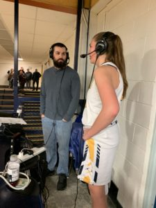 esse Anderson talks with Negaunee's Alyssa Hill after her impressive game of 16 points and 10 rebounds on Sunny 101.9.