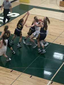 The Miners defend the basket well during the 59-21 win over Manistique on Sunny 101.9.