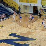 Morgan Carlson posts up looking for a pass in Negaunee's win over West Iron County.
