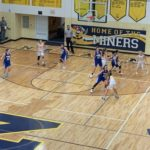 Miners vs Wykons in Negaunee's Lakeview Memorial Gymnasium.
