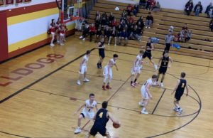 Negaunee's Jason Waterman handles the ball in his team's 70-31 victory over the Hancock Bulldogs on Sunny 101.9.