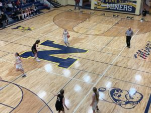 Negaunee's Larissa Anderson brings the ball up the court in the Miners' victory over the Gwinn Modeltowners.