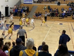 Both teams battle for a loose ball during the rivalry match-up.