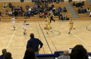 Larissa Anderson dribbles the ball across halfcourt for the Miners.