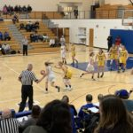 The Hematites control the ball against the Negaunee defense.