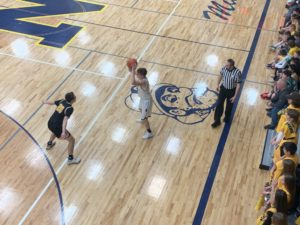 Alex Munson looks for a Negaunee teammate to pass to during tonight's game.