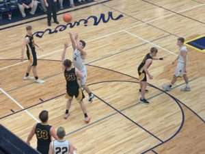 Negaunee's Jason Waterman goes up for the layup during the Miners' 71-48 win over Gwinn.