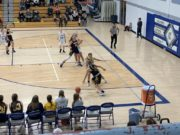 Bree Giotto looks to pass down into the post, she led the Miners with 16 points.