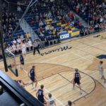 The Miners attempt a three-pointer
