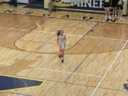 Negaunee's Chloe Norman brings the ball up the court in her team's 37-36 win over Gwinn.