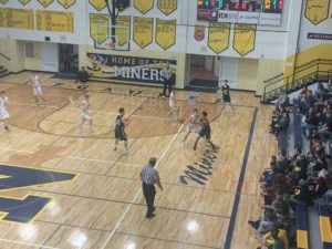 Negaunee's defense showed up in the second half to stifle the Emeralds to only 16 points. The Miners capitalized on offense to pull away for a 65-45 win.
