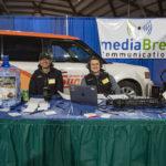 Eric Kuntz and Luke Ghiardi man the mediaBrew booth with smiles all around!