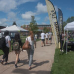 Students walking through campus during Fall Fest at NMU.