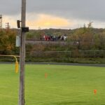 Spectators look on from the railroad tracks for tonight's game!