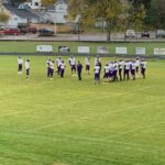 L'Anse warms up before Friday night's game at Negaunee.