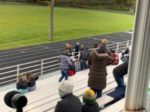 Negaunee's cheerleaders get the limited crowd fired up for the Miners' homecoming game with L'Anse.