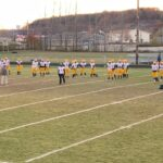 Negaunee warming up before its 28-14 victory over Gladstone on Sunny 101.9.