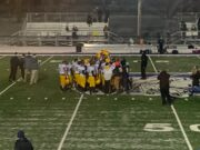 Negaunee celebrates after its 20-19 win over Calumet for the District title.