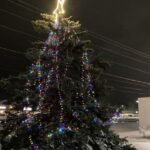 The tree is all lit! Drive by the Westwood Mall in Marquette to see it.