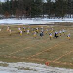 The Miners warming up before their anticipated match-up with the Grayling Vikings.